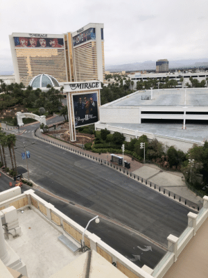 The Las Vegas strip is abandoned. So the construction workers are the only ones there.: The Las Vegas strip is abandoned. So the construction workers are the only ones there.