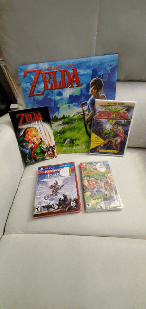 Got these from my wife and kid this morning. Merry Christmas everyone.: THE LEGEND OF  ELDA  TM  COLLECTOR'S EDITION  THE LEGEND OF  THE LEGEND OF  ZELDA  ZELDA  AVILIGHT PRIncess  The  Complete  Scason  2020 CALENDAR  AND ART B  Over 3 Hours of Action  STORY  Akira Himekawa  SPlayStation.  PLAYSTATION H  GOLLECTIONDROTANIA  HORİZ  NERO DA WN  COMPLETE EDITION  10 10  *****  9.5 10  SUNVERE  45  9.3  AUTOLENCENTS  OUERRILLA  SOUARC CNIX  ESRB  ESRB Got these from my wife and kid this morning. Merry Christmas everyone.