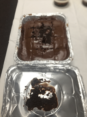 The lid took off most of the chocolate icing on our brownies.: The lid took off most of the chocolate icing on our brownies.