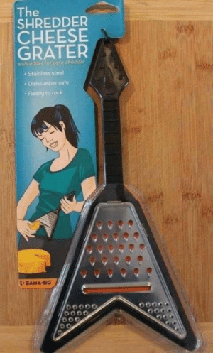 Steel, Cheese, and Rock: The  SHREDDER  CHEESE  GRATER  a she  Stainless steel  . Dishwasher safe  Ready to rock  5000 My kind of cheese grater