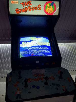 The Simpsons, The Simpsons, and Fox: THE  SIMPSONS  KONAMI  CaESoNS  TH  SIMPSON SM S 1991  207H GENTYRY FOX FTLM GORP  ALL RIGHTS RESERVED.  HDUSTRM CO  CENSEDTO KONAMI  ONAM/TM SA TRADEMARK O KONAM}LTD  GttTS RESERVED  STRY GO  INSERT  MATT GROSNIN  NEOR  FREEPLAY  Preas button  for credit  TPLAY  WOPLAY  wwa  THE  ONS  SIMPS  ATTACK The Simpsons Arcade cabinet at our local arcade.