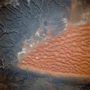 """Nasa, Space, and Dune: """"The southern half . . . of the Tifernine dunes of east-central Algeria"""" photographed from NASA's Space Shuttle Discovery (STS-70) in July 1995. """"The Tifernine dune-sea is one of the more dramatic features visible from the Shuttle when flying over the Sahara Desert."""" Photo credit: NASA"""
