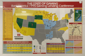 This legend: Non-tribal vs. tribal sites: THE STATE OF GAMING  BarkAmerica 1995 Gaming Lending Conference  ATLANTIC CITY  GAMING TYPES  Charitable Games  Sports Wagering  Garming Devices  Casinos  Card Rooms  HARRAHS  Bingo  TRUMP  CASTLE  Alabama  Alaska  Arizona  Arkansas  California  Maryland Avenue  SHOWBOAT  TRUMP TAJ MAHAL  Colorado  Connecticut  RESORTS  Delaware  SANDS  Florida  CLARIDGE  Georgia  BALLY'S PARK PLACE  Hawaii  CAE AS  TRUMP PLAZA  TROPWORLD  Idaho  3  3 3  Illinois  Indiana  3  BALLY'S  GRAND  lowa  ATLANTIC  Kansas  Kentucky  Louisiana  Maine  OCEAN  Maryland  Massachusetts  Michigan  Minnesota  LAS VEGAS  Mississippi  Missouri  Montana  Nebraska  Lake Med  Nevada  New Hampshire  New Jersey  New Mexico  New York  North Carolina  North Dakota  Ohio  Oklahoma  DOWNTOWN  0000000  15  3  Sara e  AAA  Soring Maurn  Oregon  Pennsylvania  Rhode Island  South Carolina  South Dakota  Tennessee  15  Femingo  Техas  Utah  Vermont  Virginia  Washington  Wash, D.C  West Virginia  Wisconsin  Tropicana Ave  Mc Carran International  Alrport  11e Cote  21 Gnd Ste  22 Hacna  Hard Rach  28 Marrh  1Aain  R Araona Chenes 13 Excalour  3 Bays  4 Barbary Onest  5 Boortown  e Bader Sttrory  7 Buo B  a Cansns Paace 18 Fremont  Caomia  ID Croun Ciroua  NEW DEVLOPMENTS  A Beaofga  41 Sara F  32 Nma Lenting Serton D  30 Paiace Soon  34 PromadorS  Bank America  13 Fema  14 Flage  13 Flamege Hon peraP 8 Ro  16 Four Quet  17 Fromer  da Baru  A Stonghe Theer  A Tro iind  47 Bapicana  Wyoming  De LatyLu  S7 La Veg Hon 37 Bahara  38 Ba own  n Bandy  40 San o  V Legal and operative  Authorized but not yet implemented  Pemitted by law and previously operative  Implemented since June 1993  19 Goit Comt  20 Golsen Nugger 30 MO Grand  29 Masim  STATION CASINOS INC.  O Pams  with special thanks to J. Craig Wilson for the concept  ATLANTIC CITY VISITOR VOLUME  LAS VEGAS VISITOR VOLUME  IN MILLIONS  SINOITIW NI  KEY GAMING PARAMETERS BY JURISDICTION  31  20  30  20  Nevada  Atlantic C