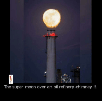 Memes, Moon, and 🤖: The super moon over an oil refinery chimney