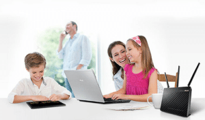 The whole family having SO MUCH FUN using wifi with their coffee cup and router photoshopped into the foreground: The whole family having SO MUCH FUN using wifi with their coffee cup and router photoshopped into the foreground