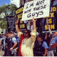 From Sunday's Gay Pride Parade in Chicago.: THE WICKE  SHALL BE  HELL AND  ALL THE  NATIONS  THAT FOR  GOD.  Psalm 0:17  WHYY  GUYS  WWNOFFICIALST REACHERSAAN From Sunday's Gay Pride Parade in Chicago.