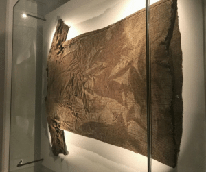 The world's oldest garment is made from lamb's wool (was excavated by glacial melt in 2011) dates back almost 2,000 years, and is on display in the Mountain Museum located in downtown Lom, Norway: The world's oldest garment is made from lamb's wool (was excavated by glacial melt in 2011) dates back almost 2,000 years, and is on display in the Mountain Museum located in downtown Lom, Norway