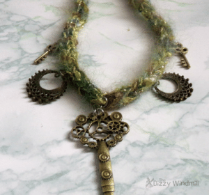 """handmadegift-ideas:    handmade steampunk jewelry, unique yarn necklace, knit jewelry,ooak,rts This handmade steampunk necklace is truly one of a kind. The cord is knit with some left over yarn, featuring eathy tones with a bit of sparkle.  A perfect addition to the casual steam wardrobe.  The two round peices between keys are re-claimed from an old pair of earrings, and with the cord being left over yarn, this unique piece is also eco friendly.  The cord is about 12"""" and the addition of the key makes its 15"""" The closure is lobster clasp with 2"""" chain making it some what adjustable.   : .The  zzy Windmill handmadegift-ideas:    handmade steampunk jewelry, unique yarn necklace, knit jewelry,ooak,rts This handmade steampunk necklace is truly one of a kind. The cord is knit with some left over yarn, featuring eathy tones with a bit of sparkle.  A perfect addition to the casual steam wardrobe.  The two round peices between keys are re-claimed from an old pair of earrings, and with the cord being left over yarn, this unique piece is also eco friendly.  The cord is about 12"""" and the addition of the key makes its 15"""" The closure is lobster clasp with 2"""" chain making it some what adjustable."""