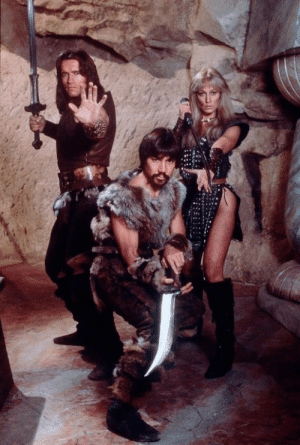 theactioneer:  Arnold Schwarzenegger, Gerry Lopez  Sandahl Bergman, Conan the Barbarian (1982)  They look like a squad of posing cosplayers and i love it: theactioneer:  Arnold Schwarzenegger, Gerry Lopez  Sandahl Bergman, Conan the Barbarian (1982)  They look like a squad of posing cosplayers and i love it