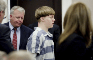 "Apparently, Church, and Family: thedeathmerchant:  charlestonchurchmassacre:  charlestonchurchmassacre:  Videos of Dylann Roof jail visits show him angering mother, making father cry Newly released videos of Dylann Roof's jail visits from family show him repeatedly provoking his mother's aggravation, making his father cry, refusing to tell his little sister he loved her and describing his hatred for his defense attorneys. What was missing? Any apparently remorse for killing nine people during a Bible study or concern about the severity of the punishments he faced. A federal judge allowed journalists to view four videos this morning of Roof's jail visits that were introduced into evidence during his two mental competency hearings. Those videos included visits from Roof's mother, father, younger sister and his mother's boyfriend. In them, Roof repeatedly laughs at his family members and prompts frustration from his father, Benn Roof, who tries to explain to his son how his actions have hurt their entire family. In one exchange two days before Roof's first competency hearing, held in November, Roof tells his father, ""I'm going to make this even worse before this makes it to trial."" ""What's wrong with you, son?"" Benn Roof asked. ""You've got to be kidding me. Don't do something stupid. You've already done enough."" The father then steps away in tears. Shortly after, Roof was found competent to stand trial and sought to represent himself. source  Roof also told his mother, Amy, that he was keeping his attorneys around ""so I can abuse them.""- ""Do you know how that sounds?"" she asked.- ""Funny?"" - ""Pathetic.""She warned that he would need his defense team, whom she insisted were good people trying to save his life. Roof, however, called them ""evil,"" ""the spawn of hell"" and ""liars."" - ""These people represent criminals and lie for them,"" Roof argued. - ""Well, guess what, Dylann?"" she said. ""You could have been an attorney. You could have been anything…""- ""I am an attorney!"" he interrupted, grinning widely. ""I'm an attorney in a capital case!""- ""I've got news for you, Dylann. It's your first and last case,"" his mother responded, voice weary.  Oh MY GOD"