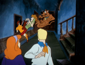 "Butt, Head, and Huh: thelittlevalkyriethatcould: scoobydoomistakes:   When I first saw this frame, I said: ""Huh, that's odd. You can actually see Shaggy's knee hit Velma. That's gotta hurt."" However, upon closer inspection… …nope, that's his butt. A very, very pointy butt.  Angular posteriors: they strike when you least expect it.   No mention of Fred's head literally being turned all the way around like an owl? 🤔"
