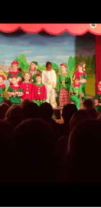 School, Dress, and Kids: These kids were asked to dress up as Elves for their school play. One kid dressed up as Elvis