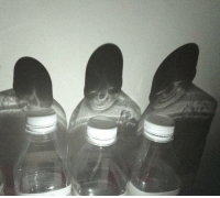 These three bottles are plotting world domination.: These three bottles are plotting world domination.
