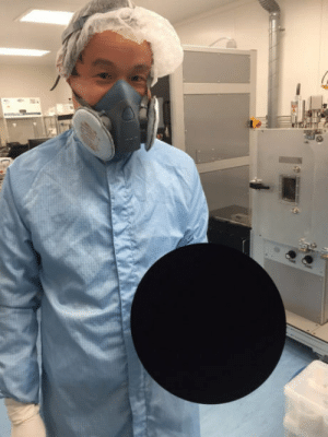 Sphere, They, and Ever: They photograph a technician, holding an actual sphere (not a disk), coated in vantablack—(the darkest pigment ever created):