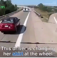 Changing your shirt while driving: This ariver IS changing  her shirt at the wheel Changing your shirt while driving