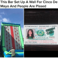 "Drinking, Memes, and Struggle: This Bar Set Up A Wall For Cinco De  Mayo And People Are Pissed  PERMANENT DRINKING CARD  NAME ORLANDO, ISABEL.  NS An 065 Z88 472  02/21 0  Country of M  RIRES  03/30/20  02/04/00  CITIZENSHIP  Dabel Orlando N PROCESS  C 1 US A065788 4722 SRC00 15 24 4397  THIS CARD ENTITLES THE BEARER TO ENJOY  ONE FREE DRINK  AT JOSE HENNESSEY'S CANTINA  with the purchase of another ofequalor greater value.One per person Valid 5/5/17only 😠😡😩 UNBELIEVABLE Hennessey's Tavern in DanaPoint, California set up an inflatable wall, and anyone who reached the top received a ""green card"" — which they could exchange for a free drink. People said the stunt was offensive to the struggle Mexican immigrants face. (📷: Laycee Barragato Gibson)"