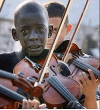 This child played a violin at his teacher's funeral. That teacher helped him escape poverty & violence through music: This child played a violin at his teacher's funeral. That teacher helped him escape poverty & violence through music