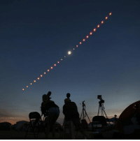 This composite image shows a time-lapse of the total solar eclipse from Madras, Oregon, USA. A huge shadow cast by the Moon as it passed in front of the Sun swept across the nation, from Oregon in the west to South Carolina in the east. Millions of people moved to get into the path of darkness, putting on their protective glasses to gaze at the sky in wonder. It was the first total solar eclipse visible from America's lower 48 states in 38 years, and the first since 1918 to track from coast to coast. PHOTO: Chris Pietsch-Register Guard-REX-Shutterstock BBCSnapshot photography moon lunar sun solar eclipse: This composite image shows a time-lapse of the total solar eclipse from Madras, Oregon, USA. A huge shadow cast by the Moon as it passed in front of the Sun swept across the nation, from Oregon in the west to South Carolina in the east. Millions of people moved to get into the path of darkness, putting on their protective glasses to gaze at the sky in wonder. It was the first total solar eclipse visible from America's lower 48 states in 38 years, and the first since 1918 to track from coast to coast. PHOTO: Chris Pietsch-Register Guard-REX-Shutterstock BBCSnapshot photography moon lunar sun solar eclipse