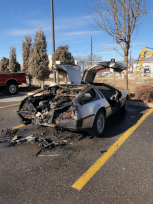 This DeLorean got rear ended. then burst into flames: This DeLorean got rear ended. then burst into flames
