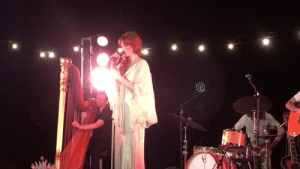 Apparently, Tumblr, and Queen: this-gay-thing:  gagasjoanne: chasers17:  sweepmoon: Florence and the Machine at last night's Spotify event in Brooklyn. As Florence began to sing Sky Full of Song a literal storm began to hit, she never faltered and embraced the storm.  Watching this was an ethereal experience   this queen literally summoned a storm during her performance when will your fave ever control the weather with such accuracy   Remember when we said Stevie Nicks was a witch, Florence is as well apparently