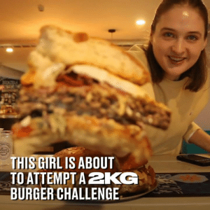Dank, 🤖, and Who: THIS GIRLIS ABOUT  TO ATTEMPTA2KG  BURGER CHALLENGE Weighing over 2kg this is the ultimate burger for that mate who loves a challenge... 🤤🍔
