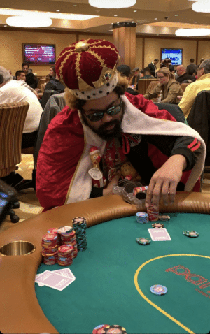 This guy dressed as the Burger King at a poker table with Oreos in his chip holder: This guy dressed as the Burger King at a poker table with Oreos in his chip holder