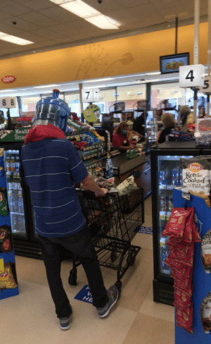 This guy in a grocery store with a water bottle on his head: This guy in a grocery store with a water bottle on his head