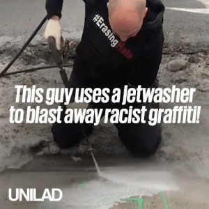 This guy uses a jetwasher to get rid of racist graffiti and it's the best thing you'll see today... 🙌🙌: This guyusesajetwasher  to blast away racist graffitil  UNILAD This guy uses a jetwasher to get rid of racist graffiti and it's the best thing you'll see today... 🙌🙌