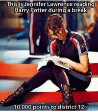 10 000 points to katniss: This is Jennifer Lawrence reading  Harry Potter during a  break  10,000 points to district 12 10 000 points to katniss