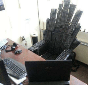 Html, Plastic, and Who: This is the plastic throne that I made from the keyboards of people who said HTML is a programing language
