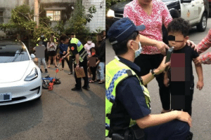 This kid hit his bike against a car. In Taiwan, any traffic accident requires a breathalyzer test.: This kid hit his bike against a car. In Taiwan, any traffic accident requires a breathalyzer test.