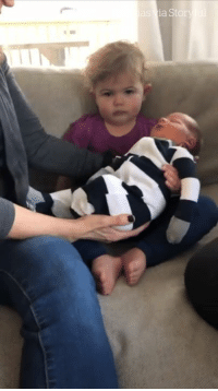 This little girl is seriously NOT impressed with her new baby brother... 😂😂: This little girl is seriously NOT impressed with her new baby brother... 😂😂