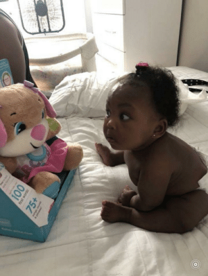 This little girl is skeptical AF & who can blame her? The bear is her size, talks, and makes strange eye contact at all times: This little girl is skeptical AF & who can blame her? The bear is her size, talks, and makes strange eye contact at all times
