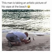 Vape: This man is taking an artistic picture of  his vape at the beach