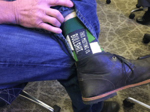 Sitting in a meeting  my boss pulled up his pant leg.: THIS MEETING S Sitting in a meeting  my boss pulled up his pant leg.