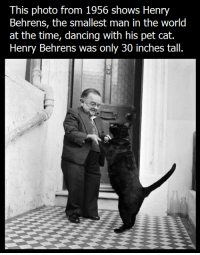 Petting Cat: This photo from 1956 shows Henry  Behrens, the smallest man in the world  at the time, dancing with his pet cat.  Henry Behrens was only 30 inches tall