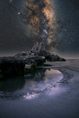 Milky Way, Rock, and Down: This pile of rocks used to be twice as high before a series of earthquakes in our city brought it down - used to be called 'Shag Rock' now the locals call it 'Shag Pile' - composite with the Milky Way rising behind it...