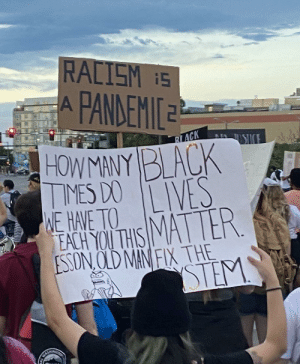 This protestors sign from the Denver march last night.: This protestors sign from the Denver march last night.