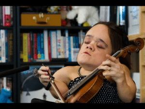 "This Tiny Desk Concert made me cry. Out of 6,000 submissions this one was the overwhelming favorite by the judges.  Gaelynn Lea, a Minnesotan based fiddle instructor and performer, plays the fiddle but holds it like a  cello due to physical constraints from brittle bone disease. Her music is haunting yet happy and full of so much passion. The first song made me cry. All these songs had an other-world quality to them yet at the same time they had a traditional flair to them as well - as if they were all ancient songs. This was one of the most unique and refreshing performances I have seen in years. I've always loved the fiddle, and this is a wonderful modern application of this gorgeous folk instrument. Please check this out; you won't regret it! side note: she also has a TedX talk titled ""Sexuality and Disability: Forging Identity in a World that Leaves You Out"". : This Tiny Desk Concert made me cry. Out of 6,000 submissions this one was the overwhelming favorite by the judges.  Gaelynn Lea, a Minnesotan based fiddle instructor and performer, plays the fiddle but holds it like a  cello due to physical constraints from brittle bone disease. Her music is haunting yet happy and full of so much passion. The first song made me cry. All these songs had an other-world quality to them yet at the same time they had a traditional flair to them as well - as if they were all ancient songs. This was one of the most unique and refreshing performances I have seen in years. I've always loved the fiddle, and this is a wonderful modern application of this gorgeous folk instrument. Please check this out; you won't regret it! side note: she also has a TedX talk titled ""Sexuality and Disability: Forging Identity in a World that Leaves You Out""."