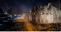 Thousands of flames light up the Tower of London to mark a century since World War 1.: Thousands of flames light up the Tower of London to mark a century since World War 1.