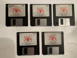 Drive, Doom, and Software: TO INSTALL DOOM II:  Go to A or B Drive  Type INSTALL and press ENTER  VER 1.7  04-30415  Disk 2  04-30415  Disk 3  04-30415  Disk 1  VER 1.7  VER 1.7  巫  巫巫  Created by id Software  Created by id Software  O 1994 id Software  Distributed by GT Interactive Software.  All Řights Reserved  Created by id Software  Distributed by  idn eratctore  1994 id Software  Distributed by GT Interactive Software.  Distributed by GT Interactive Software  All Rights Reserved.  All Rights Reserved.  CH  04-30415  Disk 5  VER 1.7  04-30415  Disk 4  VER 1.7  Created by id Software  Created by id Software  C 1994 id Software  Distributed by GT Interactive Software.  1994 id Software  Distributed by GT Interactive Software.  All Řights Reserved  All Rights Reserved My Original DOOM II Floppy Disk Set