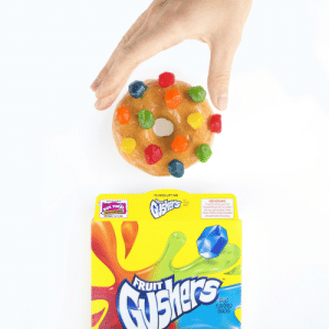 soaprock: gushers:  The ULTIMATE sprinkled donut.   : TO OPEN LIFT TAB  FRUI  FLA ORED  VAS  KEEP KIDS SAFE  To avoid choking, give Fruit  Flavored Snacks only to children  who can easily swallow chewy  oods. Children should be seated  and supervised while eating.  RUn  UIT  EDUCATION  EXPIRES 11/1/20  TM  UIT  FRUIT  FLAVORED  SNACKS soaprock: gushers:  The ULTIMATE sprinkled donut.