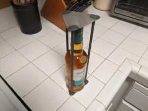 I made this for my in-laws, they'll need to figure out how to cut it open if they want a drink: Toastmaster  T  GLE  ROWING  1824  S GLENINC  THA  GLEN  EN ACD GEORGE SMITH  ESTABLIS DHSDSTILLERY  IN THE  VALLEY OF GLENLIVE  FEARS  EST  RAOOKS I made this for my in-laws, they'll need to figure out how to cut it open if they want a drink