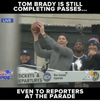 Tom Brady even finds the open man during parades.: TOM BRADY IS STILL  COMPLETING PASSES...  LIVE  12 39  DRY  TICKETS &  foe Bev England  DEPARTURES Aquarium  ADE  WBIZ  EVEN TO REPORTERS  AT THE PARADE Tom Brady even finds the open man during parades.