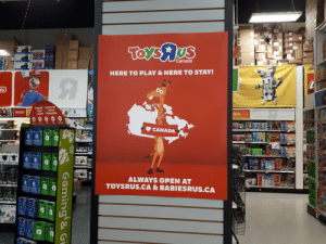 Found this old photo I had. Cant tell if this is more depressing or uplifting.: Toys US  Canada  HERE TO PLAY &HERE TO STAY!  do  Prepaid Centre de  Card  Cartes  tion  save  Centre Prépayées  Nintendo  singing machine  whx  70  $  Phone Cards  Cartes dappes  sNMNVey  W  Sam-  Can  Ca rvc  VRORVS  Intnet  CANADA  TH  70  XBO  XBCK  DA  XO  NCAA  -6  saver  70  khex  68ve  AR  1700  khex  khex  BOT  SOT  ALWAYS OPEN AT  TOYSRUS.CA & BABIESRUS.CA  XBOX  XBC  XO  BOX  Pey S  botle  Pay S  botley  XBOX  Toat  Gaming &Gi  Kb0 Found this old photo I had. Cant tell if this is more depressing or uplifting.