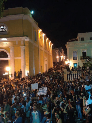 "Memes, Namaste, and Protest: TVENTO  NAMASTE  NSO RICKS  TASJODIO Mass protest in Puerto Rico due to what's being called ""telegramgate"" or ""Chatgate"", a 900 page leak of a Telegram Chat where principal executives of the island discussed public policy using memes."