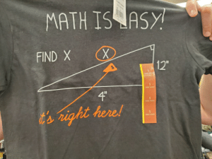 """This t-shirt with triangle labeled incorrectly: $TYLE MOT8189  8.65522 12289  MATH IS ASY  A15,00  12  FIND X  SHORT SLEEVE  SHORT SLEEVE  4""""  S  SHORT SLEEVE  SHORT SLEEVE  t's right here!  S This t-shirt with triangle labeled incorrectly"""