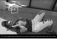 U.S. Army soldier getting attacked by an enemy helicopter during the Korean war (circa 1951)