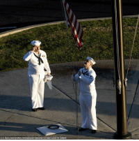 "Memes, New Year's, and Navy: (U.S. Navy photo by Mass Communication Specialist 1st Class Corwin M. Colbert Culinary Specialist 2nd Class Gerado Taddei and Yeoman 2nd Class Andrew Thompson fly the ""First Navy Jack"" to start the New Year on Joint Base Pearl Harbor-Hickam."