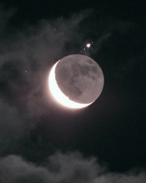 Target, Tumblr, and Blog: ufo-the-truth-is-out-there:  Jupiter and 4 of her moons peaking out from behind our moon!